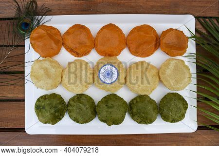 India Tricolor / Tricolour Food Breakfast Of Spinach Puri, Carrot Puri, And Plain Puri. Concept For