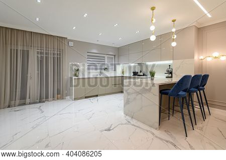 Luxury large modern white marble kitchen united with dining room and living room