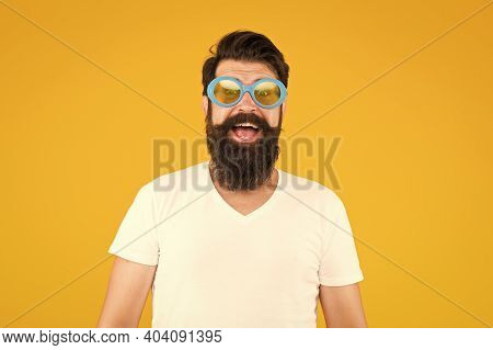 Fashion Eyewear You Want To Wear. Happy Hipster Yellow Background. Hipster Smile In Fancy Glasses. B