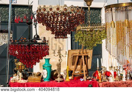 Different Objects For Sale In The Antique Flea Market Called Feira Da Ladra In Alfama At Campo De Sa