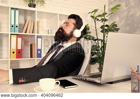 Chillout Music For Busy Man. Business Man Listen To Music In Office. Bearded Man Wear Modern Headpho