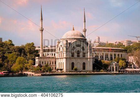 Sunset View On The Bank Of Bosporus Strait With Dolmabahce Mosque In Beyoglu District Of Istanbul