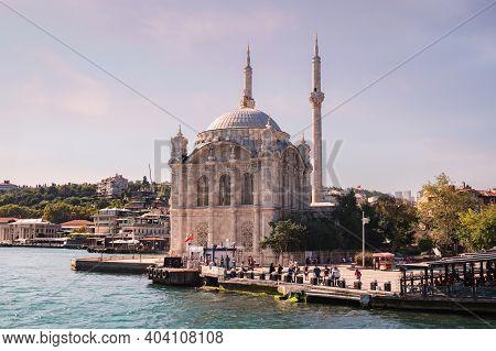 Istanbul, Turkey - 09 07 2020: View From The Waters Of Bosporus Strait On The Buyuk Mecidiye Ortakoy