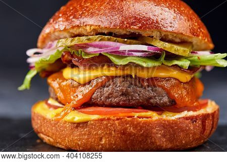 tasty burger with beef cutlet and vegetables