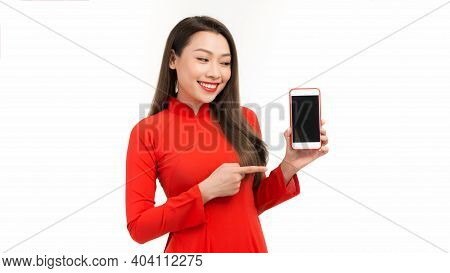 Asian Woman In Ao Dai Tranditional Dressing Pointing At Empty Smart Phone