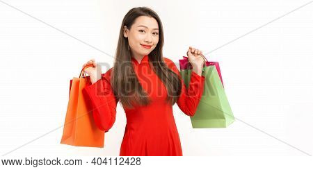 Happy Asian Woman Holding Shopping Bags And Wearing Ao Dai Vietnam