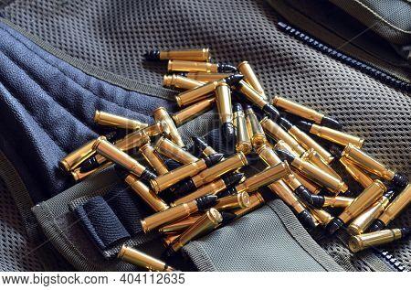 Ammunition 7,62*39.Tactical unloading vest as background. October 23, 2020.Kiev,Ukraine