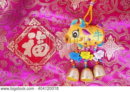 Tradition Chinese cloth doll ox,2021 is year of the ox,calligraphy translation:good bless for new year,word on doll ox mean ox