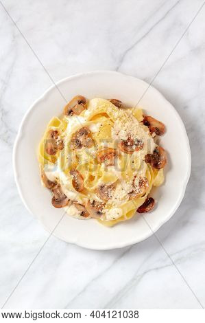 Pappardelle Pasta With Mushrooms, Cream Sauce And Cheese, Shot From Above With A Place For Text