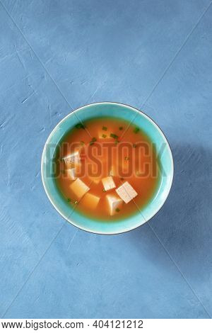 Miso Soup With Tofu And Scallions, Top Shot On A Blue Background