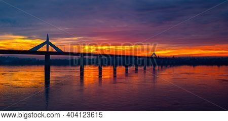Panorama Beautiful Sky On Twilight Time And Sunlight Through The Bridge On The River And Silhouette