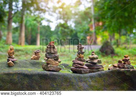 Balanced Rough Stone Pyrami, Stack Stone In The Forest And Green Blurred Background
