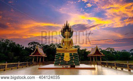 Beautiful Golden Buddha  Statue At Evenninig Time,wat Phra Bung Kao Laung,ubon Ratchathani Province,