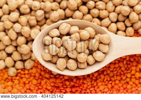 Uncoocked Raw Chickpea In Wood Spoon On Chickpea And Lentil Background, Close Up. Protein For Vegan