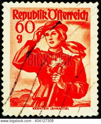 Moscow, Russia - January 14, 2021: Stamp Printed In Austria, Shows Woman In National Austrian Costum