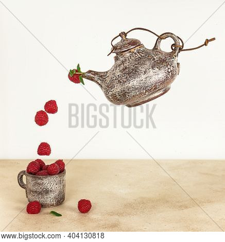 Flying Raspberry From The Teapot. Levitation Photo, Summer Concept With Copy Space.