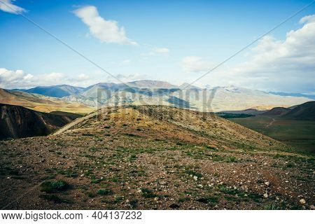 Awesome Vast Landscape With Vivid Multicolor Mountains. Scenic View To Stony Hill And Mountains Unde