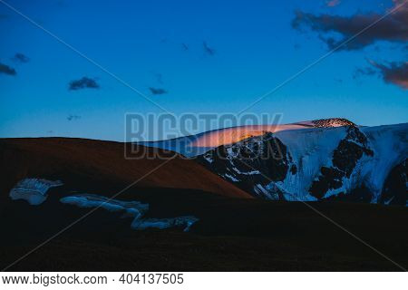 Atmospheric Dawn Landscape With Silhouettes Of Snowy Mountains With Glaciers. Colorful Mountain Scen