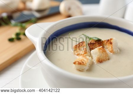 Delicious Cream Soup With Croutons In Bowl On Table, Closeup