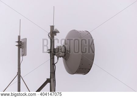 Close Up Top Of Communication Tower With Antennas Such A Mobile Phone Tower, Cellphone Tower, Phone