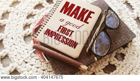 Make A Good First Impression Written On Book Cover, Eyeglasses And Pen. Business Career Motyvation C