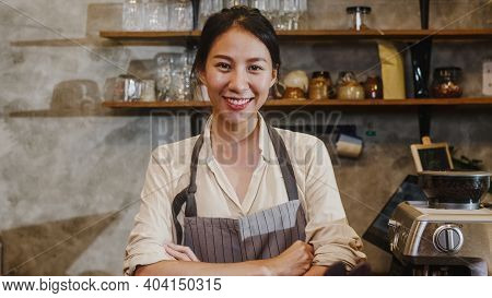 Portrait Young Asian Woman Barista Feeling Happy Smiling At Urban Cafe. Small Business Owner Indones