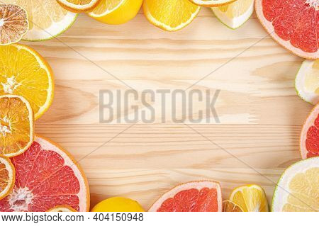 Citrus Frame Template On Wooden Background. Fresh Citrus Fruits. Top View Of Sliced Citrus Fruits. F