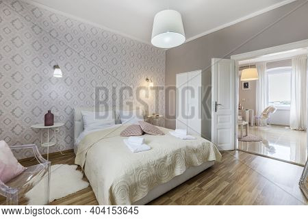 Illuminated Interior Of Modern Luxury Bedrooom Accommodation