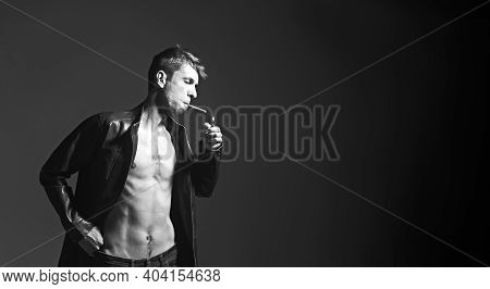Vertical Shot Brutal Bearded Biker Man Dressed In A Black Leather Jacket. Free Space For Text.