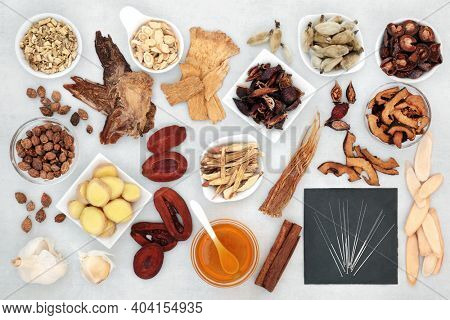 Chinese treatment for cold and flu prevention and remedy with acupuncture needles and  herbs used in traditional herbal medicine. Used to treat fever, lung disease and coughs. Holistic health care.