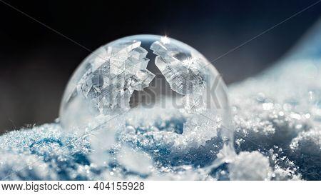 Frozen Bubble With Bokeh Background. Beautiful Frosty Patterns On Frozen Soap Bubble