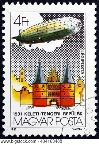 Hungary - Circa 1981: A Stamp Printed In Hungary Shows Graf Zeppelin Over Holsten Tor, Lubeck, Balti