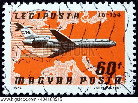 Hungary - Circa 1977: A Stamp Printed In Hungary Shows Plane Tu-154, Malev Over Europe, Circa 1977