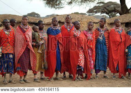 Masai Mara, Kenia - August 23, 2010: Group Of Unidentified African Women From Masai Tribe  In Multi-