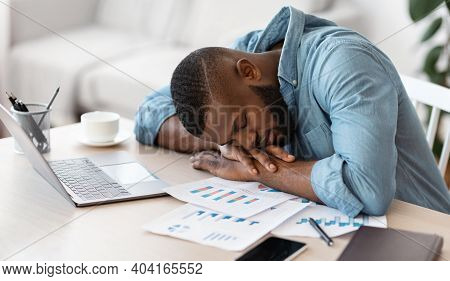Sleep At Work. Exhausted Black Male Freelancer Napping At Desk At Home Office, Overworked African Am