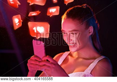 Happy Millennial Woman Using Smartphone With 3d Hearts And Like Buttons Networking In Social Media S