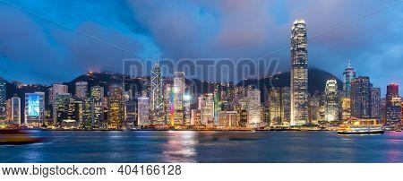 Hong Kong, China downtown cityscape from the harbor at dusk.