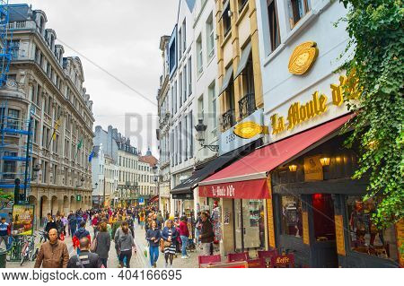Brussels, Belgium - October 06, 2019: Crowd Of People Walking By Old Town Shopping Street Of Brussel