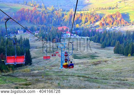 Autumn Landscape Cable Car Uphill. Cable Car Cabins Leading To The Mountain National Park. Cable Car