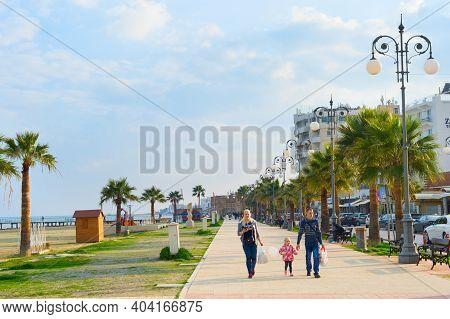 Larnaka, Cyprus - Feb 18, 2019: Family By Larnaca City Promenade Of Larnaka In Bright Sunny Day. Cyp