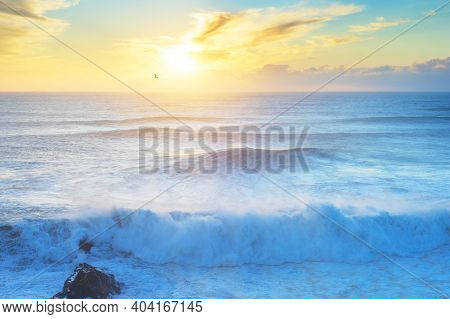 Waves At Atlantic Ocean At Sunset. Nazare, Portugal