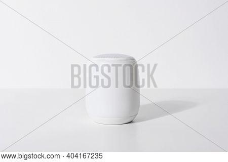White smart speaker voice assistant digital technology