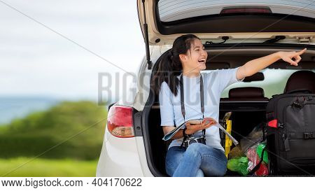 People Young Woman Traveler And Tourism Holding Map And Pointing Trips Travel On Hatchback Car To De