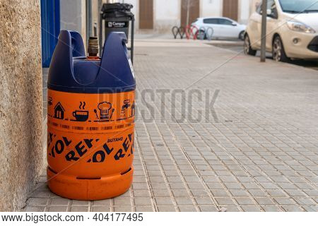 Campos, Spain; January 20 2021: An Empty Butane Cylinder At The Door Of A House Waiting For The Buta