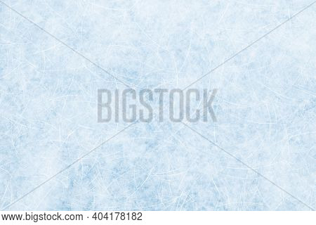 Ice Blue Background With Ice Skating Tracks. Frozen Water, Sea. Frosty Ice Texture With Winter Graph