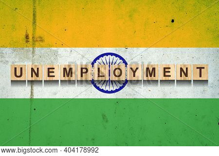 Unemployment. The Inscription On Wooden Blocks On The Background Of The India Flag. Unemployment Gro