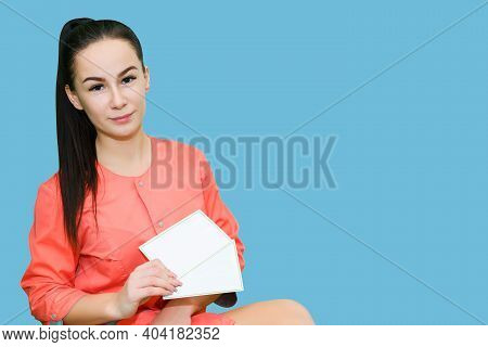 Young Woman In Medical Uniform Holds Paper Billboards For Copy Space. Portrait Of A Young Female Med