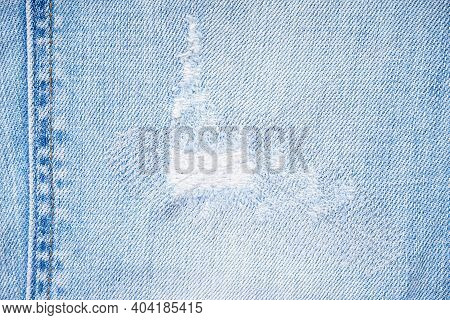Ripped Jeans Blue Denim Texture, Ripped Stylish Trousers. Modern Denim Trousers, Close Up.