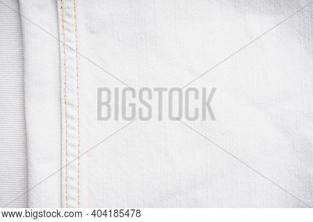 Stylish Vintage Jeans. White Denim Jeans Fabric Background.