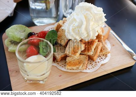 Toast ,butter Toast Or Toast With Fruit And Whipping Cream Topping